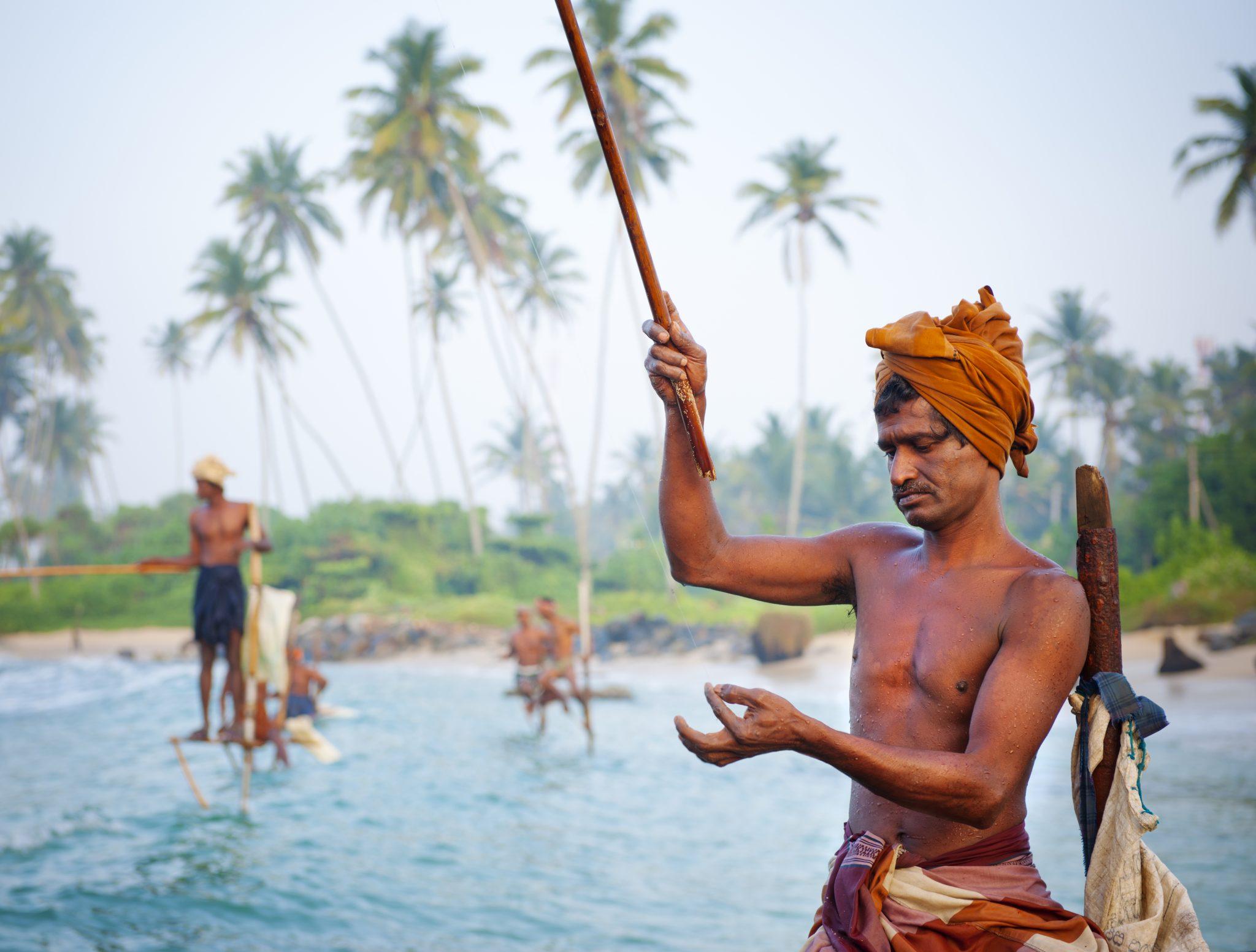 Screen-Galle-Destinations-Rising-sri-lanka-stilt-fishermen-in-sri-lanka